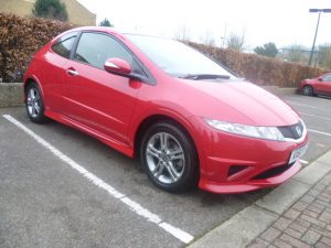 Red Honda Civic gleaming after car valet by mmvaleting.