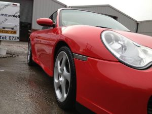 Shiny red sports car after a car valet from mmvaleting.