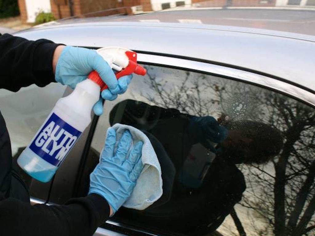cleaning windows with autoglym bottle shown. mmvaleting provide car valeting and detailing services throughout Buckinghamshire.