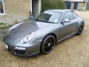Silver Porsche sits outside after full valet by mmvaleting