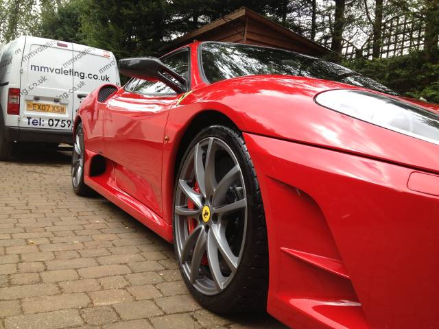 A shiny clean red Ferrari after a valet from mmvaleting - car valeting and detailing in Buckinghamshire.